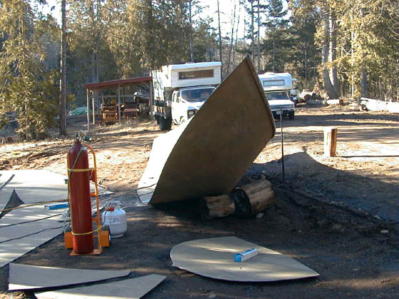 A half hull has been pulled into shape - Origamiboats: The Art of Frameless Steel Boatbuilding